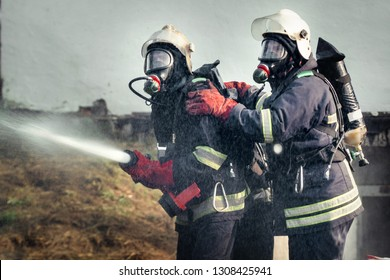 Firefighters training, foreground is drop of water springer