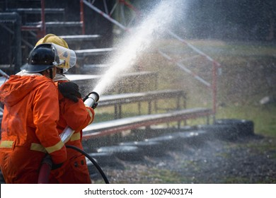 Firefighters training, Team practice to fighting with fire in emergency situation.Spray water to the flame