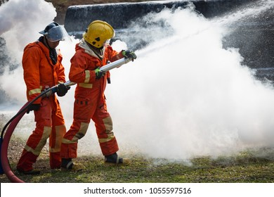 Firefighters training, Team practice to fighting with fire in emergency situation.