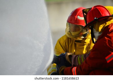 firefighters training to use fire hose and control fire with water