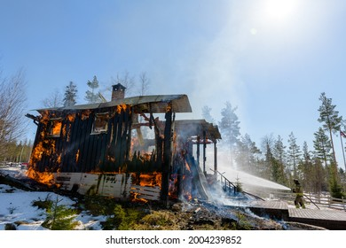 Firefighters trying to put out flames cabin on fire