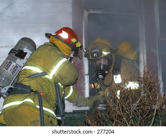 firefighters at window