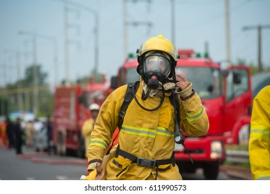 firefighters at work in oxygen suit