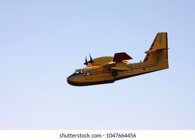 Firefighting plane descending in dusk in Croatia