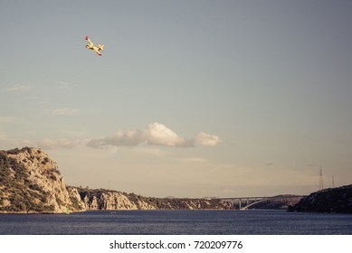 Firefighting plane, over inland channel, Zaton, Sibenik, Croatia