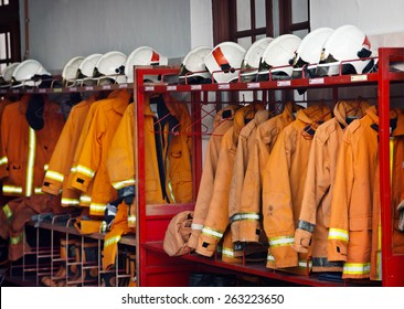 Firefighting safety equipment, including helmets, flame-resistant jackets and boots, arranged on a rack at the Georgetown Fire Station.
