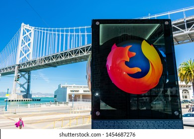 Firefox logo near office of a not-for-profit Mozilla Foundation in downtown. Bay Bridge in background - San Francisco, California, USA - July 12, 2019
