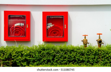 Firehose in Red Box,Pipe roll for fire emergency in red metal boxes on the concrete wall.