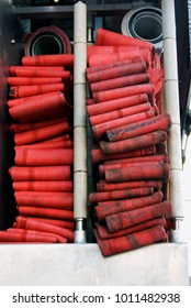 Firehose in a truck to be used by firefight.