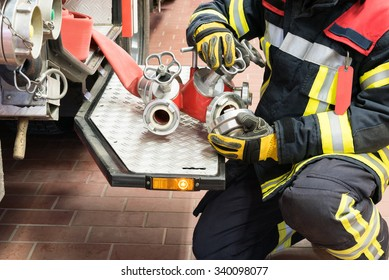 Fireman in action connect a water hose