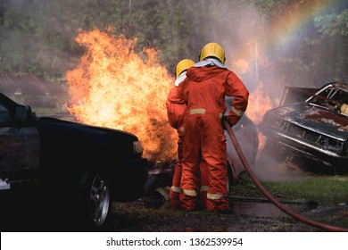 Fireman Enter the fire to burn the car from the accident.