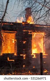 Fireman extinguish a burning building after an explosion