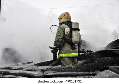 Fireman extinguish a fire on the roof of the house