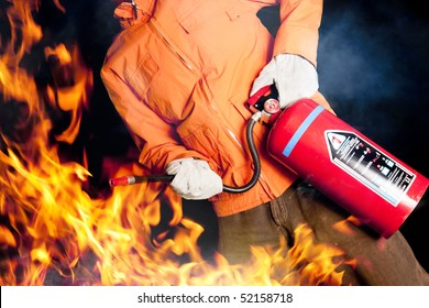 fireman with extinguisher fighting a fire