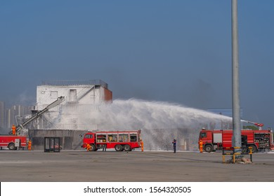 Fireman extinguishes foam spraying for firefighting from the fire truck cable car during a fire caused by chemicals with copy space
