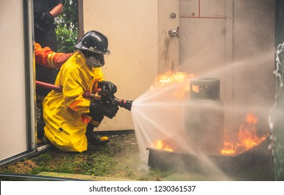Fireman in Fire Fighting and Evacuation Fire Drill Simulation Training For Safety in Condominium or Factory