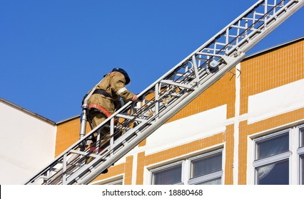Fireman goes upward on a ladder