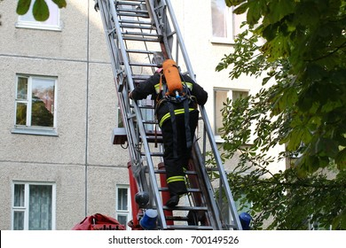 The fireman in the helmet ascends the automatic staircase