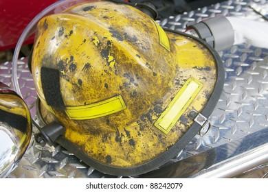 fireman helmet on fire truck bumper