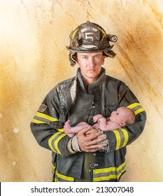 Fireman holding baby on a golden textured background with lighting effects