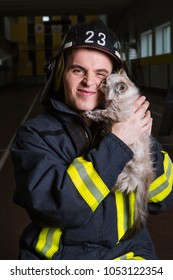 fireman with a kitten in his hands