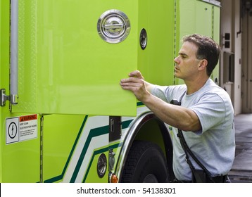 Fireman looking for supplies in his fire rescue truck