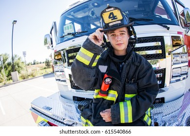 fireman posing with in front of a new fire truck