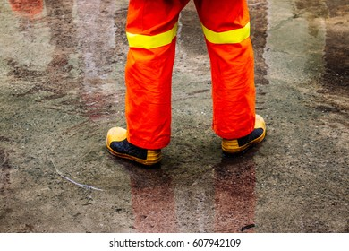 fireman in protective boots and pants