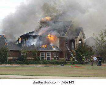 Fireman responding to house fire