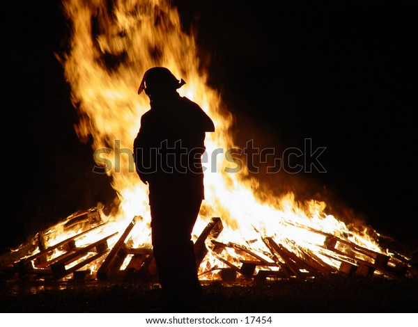 Fireman shilouetted against a large fire