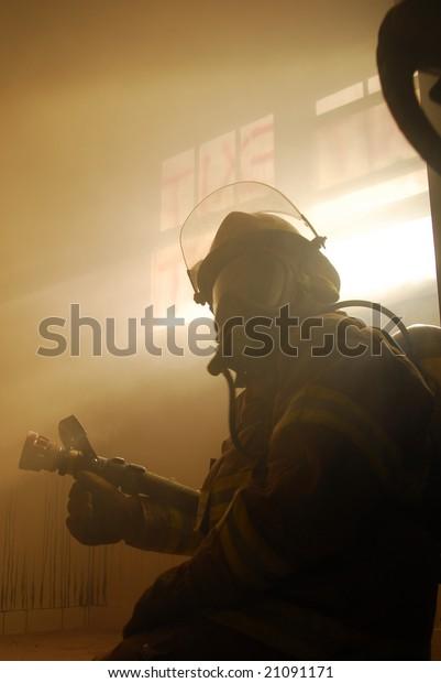 fireman in smokey room