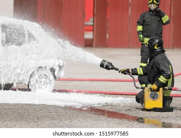 fireman uses a foaming agent to put out the fire that broke out in a car