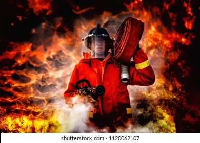 fireman wearing firefighter suit holding a fire hose and nozzle to using water and extinguisher to fighting with fire flame in an emergency situation., burning building in background.