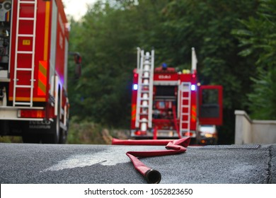 fireman's cane after a fire with a truck behind it out of focus, fire fighters