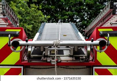 Firemans ladder on top of fire truck / Engine