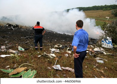 Firemen attending the scene of a fatal airplane crash with thick gray acrid smoke.