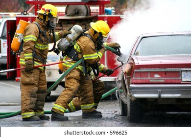 firemen with burning car