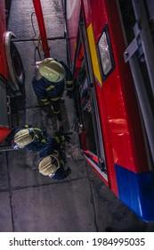 Firemen checking the fire engine inside the fire department from a bird perspective