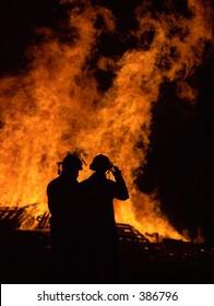 Firemen controlling a fire.
