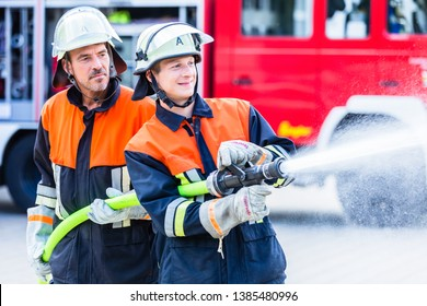 Firemen of the fire department extinguish fire