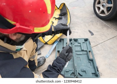 Firemen practicing techniques of rescue of victims in traffic accidents with tools