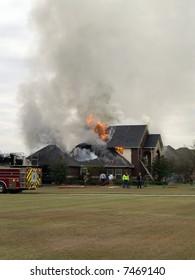 Firemen responding to house fire