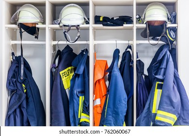 Firemen suits and helmets at wardrobe