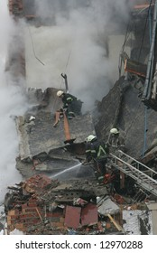Firemen working after a gas explosion in an appartment house.