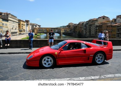 FIRENZE (FI) - 15 MAY 2011: unidentified drivers on a Classic Ferrari F40 car during Mille Miglia 2011 in the centre of Florence, Italy.