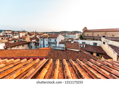 Firenze or Florence, Italy historic city with roof architecture on summer evening sunset cityscape skyline aerial high angle view from urban rooftop