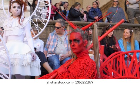 Firenze, Florence / Italy - March 15 2019: During the Firenze Fantast Festival, the city was full of cosplayer. Here a red demon girl with strong eyes.