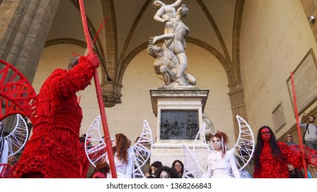 Firenze, Florence / Italy - March 15 2019: In front of Loggia dei Lanzi, during the Firenze Fantasy Festival, cosplayers are walking and showing their costumes.