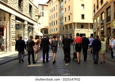 Firenze, Italy - April 21, 2017: People walking along a busy pedestriansed street in Florence, Firenze, Tuscany, Italy