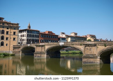 Firenze, Italy - June 21, 2018 : View of Ponte Santa Trinita (Holy Trinity bridge), the oldest elliptic arch bridge in the world.